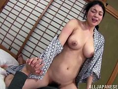 a natural titjob from a lovely japanese milf