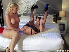 Kagney Linn Karter and Monique Alexander are two gorgeous ladies in sexy stockings, They suck each others tits and lick each others pink pussies eagerly right in front of Keiran Lee.