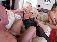A couple of curvy blondes have a cock riding competition