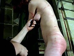 How much of this brutal punishment can this slave take from her master? He has her locked away and tied up tightly. First she is hanging from the ceiling and then, she has her ass beaten so hard. There are so many red welts on her ass.