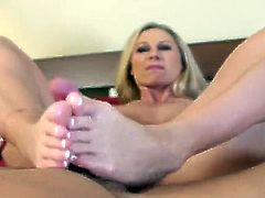 Horny MILF gives foot job and massages dick in POV