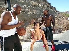 Hot MILF porn star Lisa Ann with huge tits and bubble ass is extremely sexy in her skin tight outfit. She turns black guys on as they play basketball together in the open air.
