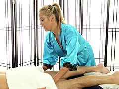 She works her hands all over her body and helps him relax. She sees, that he is getting a boner, when she is rubbing him down. When the towel comes off, his cock is rock hard and she sucks on his stiff rod.
