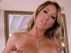 Capri is one of the most sensual milfs with big amazing tits ever. She has a mysterious smile and a naughty look. The blonde-haired lady masters the art of seduction, as one can observe from the video where she is masturbating. One can tell she loves her curvy body, from the gentle way she touches herself.