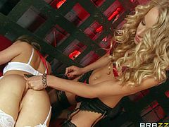 Lingerie-clad kinky lesbian ladies Aubrey Star and Staci Carr have wild sex in a cage. Slave girl in white gets her pink pussy toy fucked by blonde in black. She gets spanked and dildo fucked at the same time.