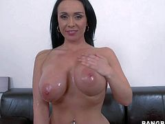 Gorgeous dark haired busty European MILF Sandra with huge boobs and round butt takes off her blue jeans and then her pink bra. She shows her cunt with her panties on. Shes a breathtaker!