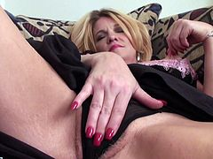 Are you fond of slutty milfs? The blonde housewife in the video loves to be in front of the camera, doing nasty things. The bitch lays on the couch in a comfortable position and reveals her boobs. You can see Sybil pinching her small nipples, before playing with her lusty cunt. The details are exciting, click!