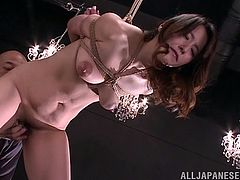 Do you find Japanese sluts getting into weird troubles very exciting? Nao, is a brown-haired gorgeous lady, that has been tied up strongly in a rope bondage. The naked milf has become the slave of a dominant guy, that whips her with no mercy. Click to see the obedient bitch sucking cock!