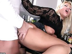 Blonde Sarah Simon with gigantic hooters sucks like a sex crazed animal in steamy oral action