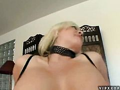 Blonde Andi Anderson with huge knockers rubs her pussy the way she loves it