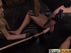The atmosphere gets hot, when three kinky lesbians gather to play dirty games, especially when they use sex toys like dildos and vibrators, to arouse a brunette slave, who has been tied up in a fierce rope bondage. Pain mixes with pleasure and you can see the busty obeying slut, fucked from behind with a strap on.