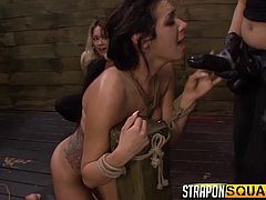 Blonde Mila and hot Isa get entertained by playing dirty. Their naughty games wouldn't be complete without the presence of a slutty slave. The helpless lesbian has been fiercely tied up in a rope bondage and then hanged upside down, with a dildo in her cunt. Watch her sucking dildo or fucked with strap on.