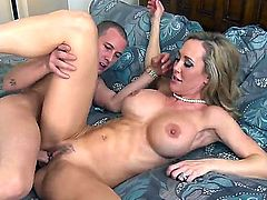 Brandi Love is a busty MILF beauty with nice body. Experienced woman with massive hooters gets her trimmed bush banged in a wide variety of sex positions on a king size bed. She is horny as fuck!