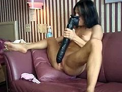 Kream rubs a giant dildo between her boobs and then squeezes her breasts together over the fake cock. She sucks it hard and then shoves it into her tight pussy. What a dirty slut she is to take such a huge dildo this deep.