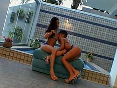 Brazilian Lesbians with Natural Tits and In High Heels get naughty at the Pool as they lick and finger their Pussies and Hot Ass then Fuck with Toys