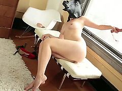 Playful brunette Kimberly Kane with natural boobs and bushy pussy displays her nice nude body before having fun. She inserts black dildo in her tight anal hole with her horse mask on. She does it for the camera eagerly. Kimberly Kane loves extreme sextoys!