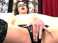 Topless glassed girl Jay Taylor in black nylons and crotchless panties rubs her slit with her long legs apart before she takes man meat in her eager  mouth. This small tity chick loves cock sucking.