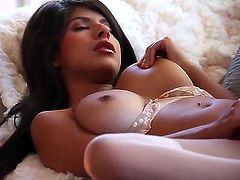 Dark haired sexy babe Layla Rose gets some pleasure alone with her hand son her sexy big boobs and wet pussy. This stacked beauty goddess has a great time stroking her snatch with legs apart.