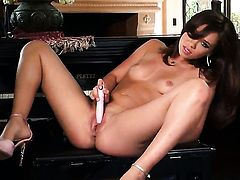 Capri Anderson poses seductively before masturbating