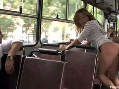 She has her boobs grabbed in public, but she doesn't mind. She is going to show how good she is at giving handjobs and blowjobs right on the bus. She is pounded from behind and sucks on his balls, as the fellow passengers look on.
