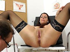 She has come to see the gynaecologist, so he can check out her vagina, to see what is wrong with her. He examines her pussy and checks things out. Everything looks OK, but he wants a closer look, so he uses a speculum to get a really nice view inside.