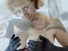 Mature Naomi XXX with curly red hair is wearing her sexy lingerie and she decides to remove it as she squeezes her tits and spreads her big pussy in front of the camera.