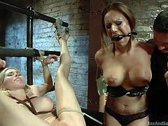 With two babes in his sex dungeon the master is going to have some fun. One is tied up in rope, and the other is made to eat out her pussy by order of the master, who guides her in. His cock is rock hard now, and she has to suck on it.