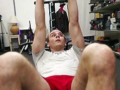 Sexy hot fitness trainer demonstrate his gym equipment butt naked and sucked two dicks