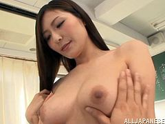 In this Japanese classroom, this lovely brunette babe is going to have a nice time with her horny student. She unbuttons her top and lets him feel her massive boobs. She is so very, very hot for him too and loves to let him touch her.