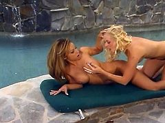 Watch this lesbian action by the pool with this sizzling blonde and sexy brunette licking some sweet pussy in this free tube video.