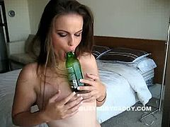 Bottle teasing whore solo on camera. This brunette newbie will do anything for her horny fans watching her every moves all over the world. Her delicious pussy is up for grabs.