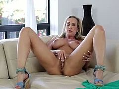 Stunning cougar Brandi Love shows off her huge boobs and athletic body in a tiny thong and then uses both hands to bring her craving cunt to body shaking orgasm. Watch her boobs and horny pussy in action. Enjoy!
