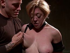 A short-haired blonde bitch is awfully treated by a dominant sadistic guy. The man loves to see her naked and vulnerable. Watch how slutty Darling's nipples are pinched in a harsh way. But nothing compares to the rough style of the mouth fuck, she's about to become the subject of. See the kinky details!
