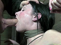 Chained brunette slut gets mouth fucked by her BF rough