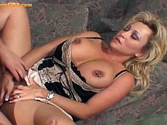 Blonde MILF with huge natural titties and pierced nipples having the good time with her lover as he pounce that hungry wet pussy making both of them moan in great sensation.