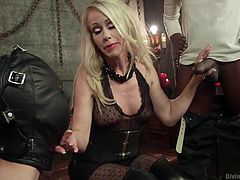 The gimp slave has to do what the beautiful blonde mistress makes him do and today, she makes him suck on some big black cock. The juicy dick is in his mouth, as he gags on the cock under the guidance of his beautiful mistress.