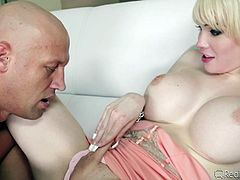 Sarina, the beautiful blonde with nice titties, is a horny shemale, who loves to suck cock. The bald guy, Chris, was the lucky one to get this sexy tranny's suck service. He kissed her passionately and then, went between her legs, to suck her penis as well, as licking her nipples. Watch them playing!