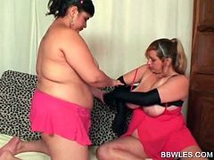 Two horny BBW lesbian tasting eachother's big tits in bed