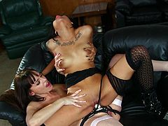 Tattooed lesbian drilling her partner to orgasm with a strap on