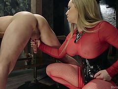 Aiden is a divine bitch and she looks super sexy, wearing her fishnet body suit. She makes him suck on her strap on and then, pegs his tight little asshole. She jacks him off and milks his cock like the dirty slave he is.