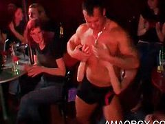 Muscled stripper dancing with lucky party girls at CFNM orgy