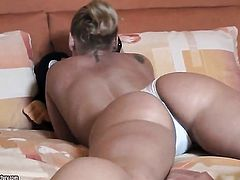 Blonde Kathia Nobili kills time stroking her twat