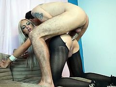 Her man is so horny for that sweet tranny asshole, that her pantyhose are ripped open wide, revealing her amazing ass. He sucks her off hard and pounds her tight asshole with his great big cock. Soon, he is ready to blow, after she rides him. The cum get sprayed all over her sweet tits