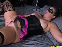 This busty black haired lady has amazing desirable body, with magnificent boobies and chubby ass. She was wearing a mask, as she was tied to the bed pole for her lover. The guy came in with kissing and lots of pussy fingering. He dipped his face between her soft chubby thighs and licked her cunt.