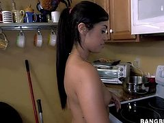 Young raven haired sexy maid Eva Saldana is totally naked in the kitchen. Naughty girl with small boobs and ass shows every inch of her sexy body. This sexy chick is so fucking sexy!