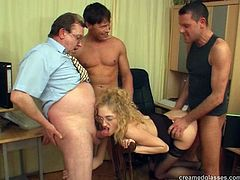 Office nerd is quite the cock slut in a great gangbang video