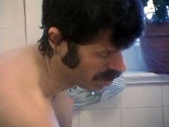 Ebony cutie provides moustached dude with blowjob in the bathroom