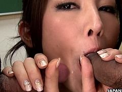 Nasty teacher Julia Nanase gives blowjob to male colleagues