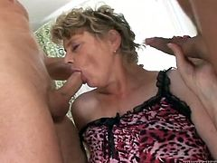 Big bottomed chick with full natural jugs gives blowjob to horny young neighbors