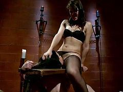 Brunette mistress makes restrained gal lick her shaved muff